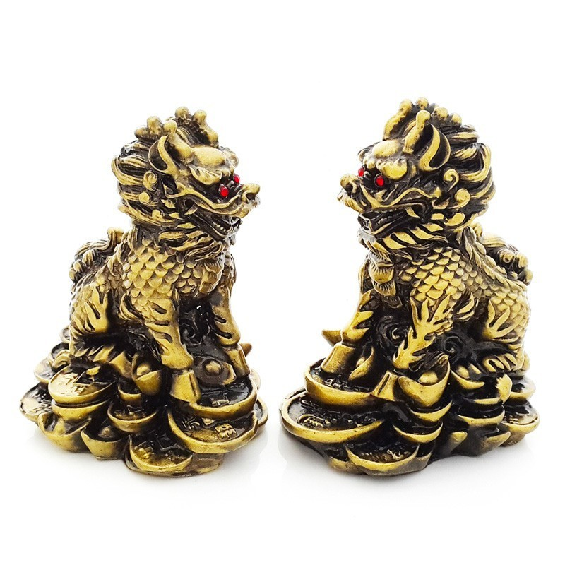 A Pair of Resting Chi Lin - Bronze