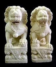 A Pair of Marble Temple Lions with Stand