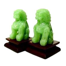 A Pair of Jade Temple Lions on Stand